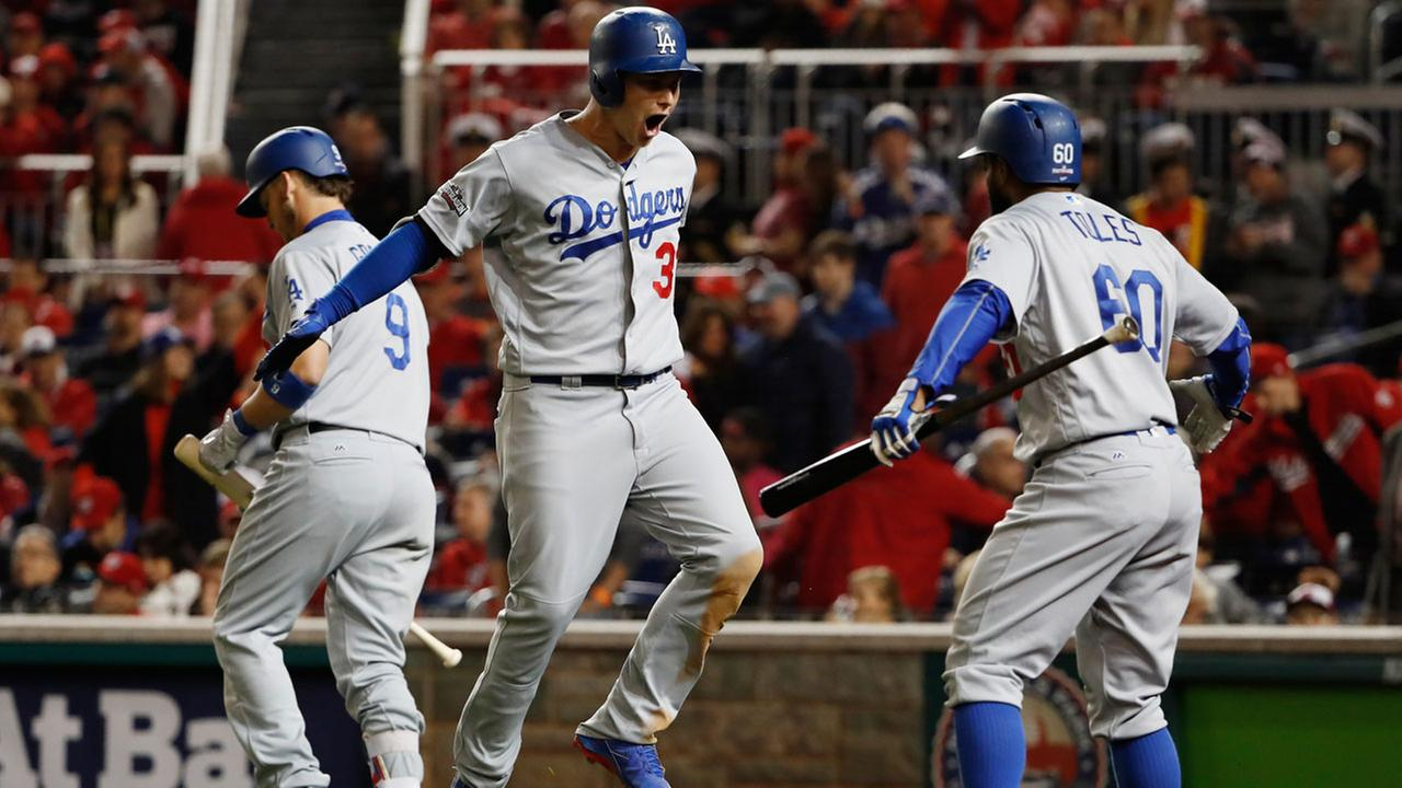 Los Angeles Dodgers Joc Pederson celebrates his solo home run with his teammates during the seventh inning against the Washington Nationals on Thursday, Oct. 13, 2016.