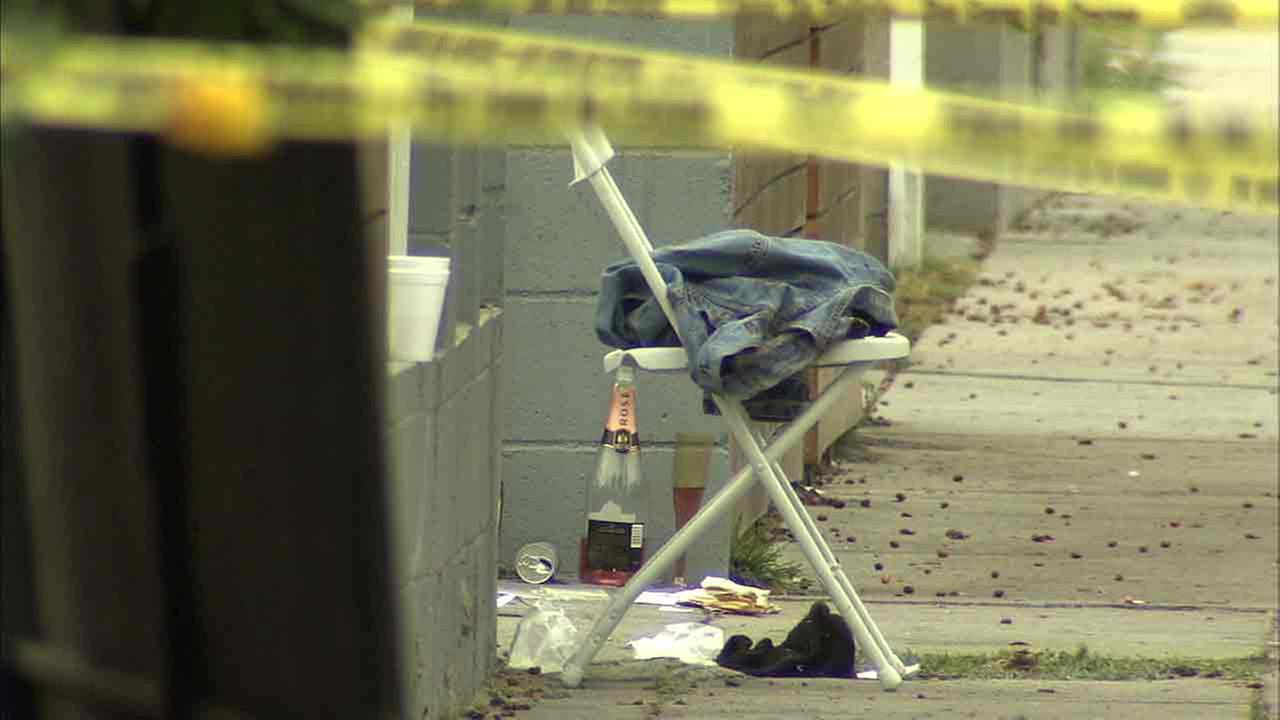 A champagne bottle and pieces of clothing scattered the day after a house party shooting that left three people dead in L.A.s West Adams area early Saturday, Oct. 15, 2016.