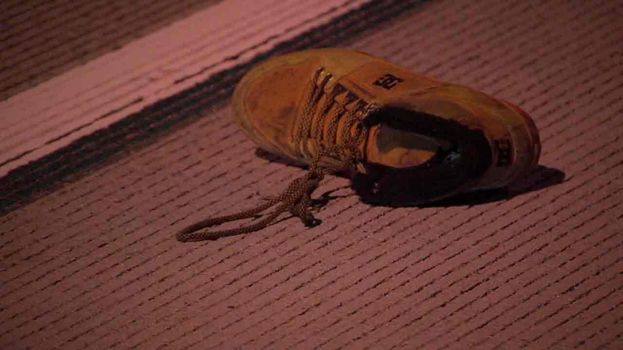 A shoe believed to belong to a man who was struck and killed in Del Mar after falling off an RV on the 5 Freeway on Monday, Oct. 18, 2016.