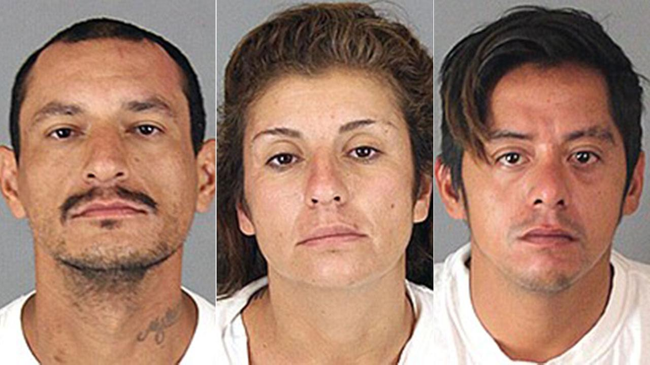 Suspects Raymundo Ramirez (L), Gabriela Ayala (C), and Angel Acosta (R) were arrested after the discovery of human remains on a Mead Valley property.