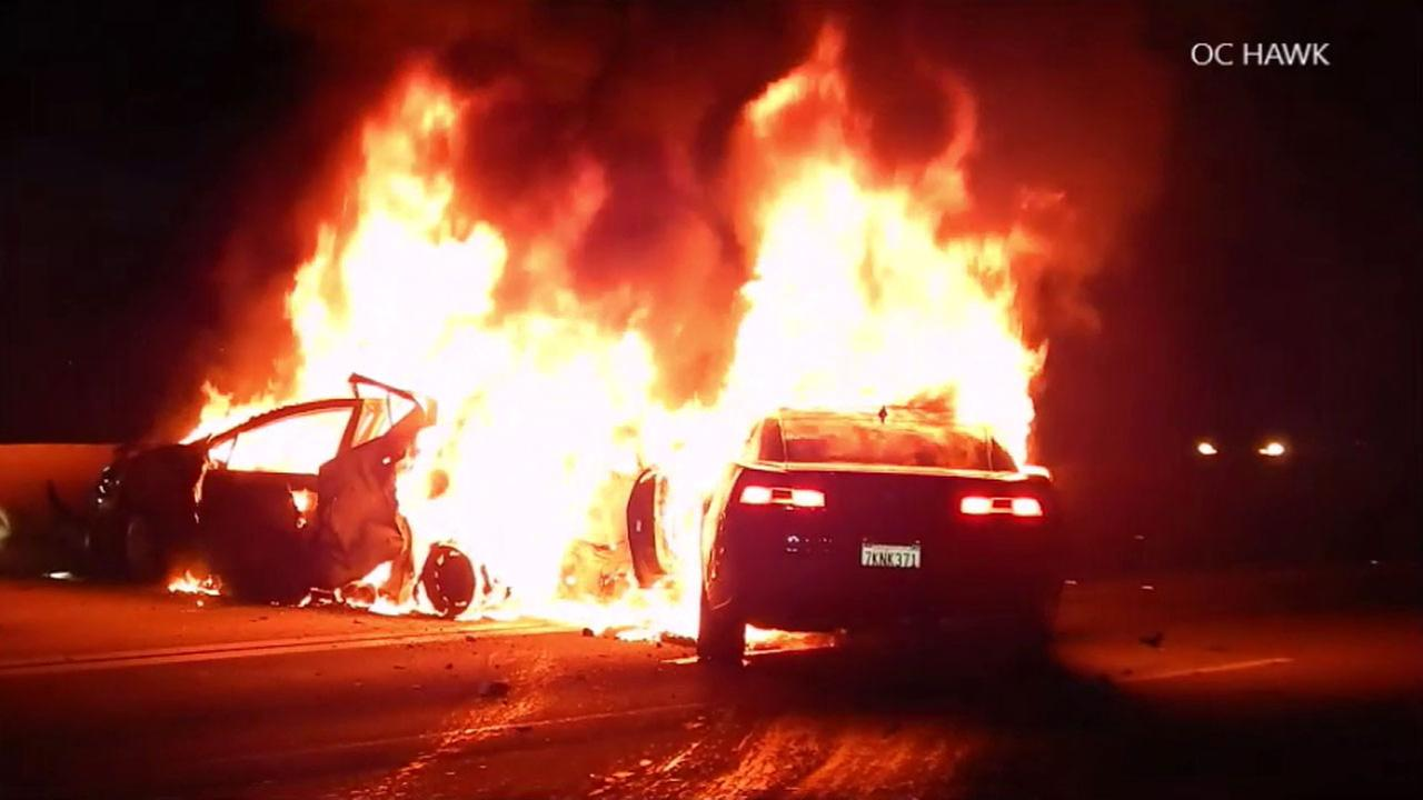 A Toyota Prius and Chevy Camaro burst into flames after crashing on the northbound 605 Freeway in Whittier on Monday, Oct. 24, 2016.