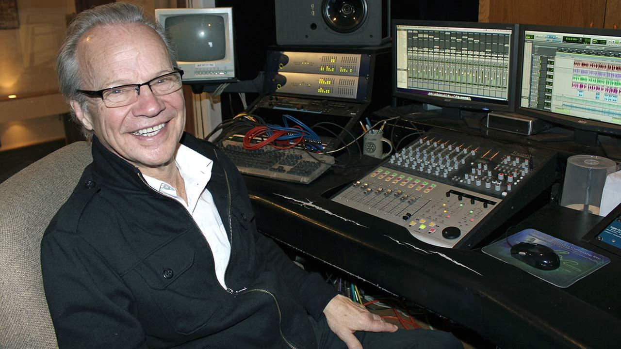 In this photo made Dec. 18, 2013, Bobby Vee poses at his studio console at his familys Rockhouse Productions in St. Joseph, Minnesota.