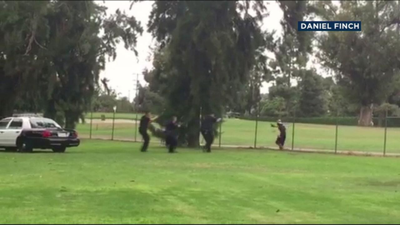 Long Beach officers used non-lethal force to arrest a woman suspected of threatening a child with a knife at a dog park on Sunday, Oct. 23, 2016.