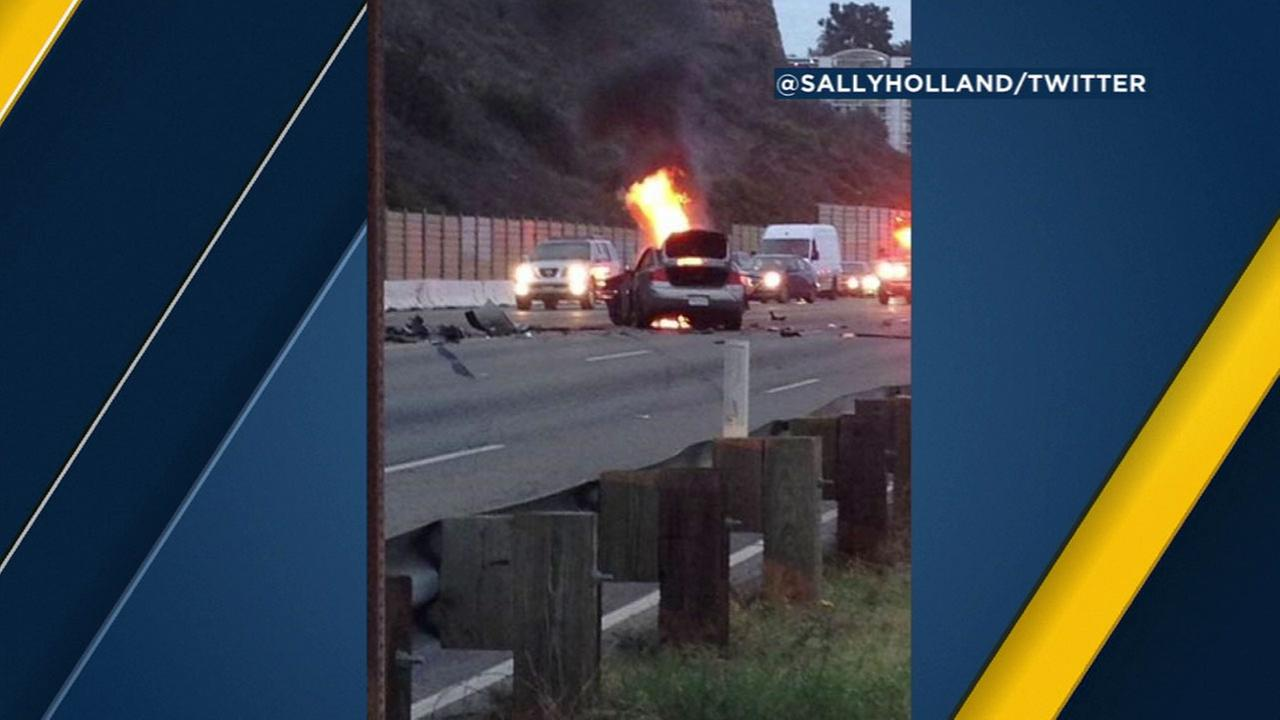 A witness captured a car on fire after a crash on the Pacific Coast Highway in Pacific Palisades on Saturday, Oct. 29, 2016.