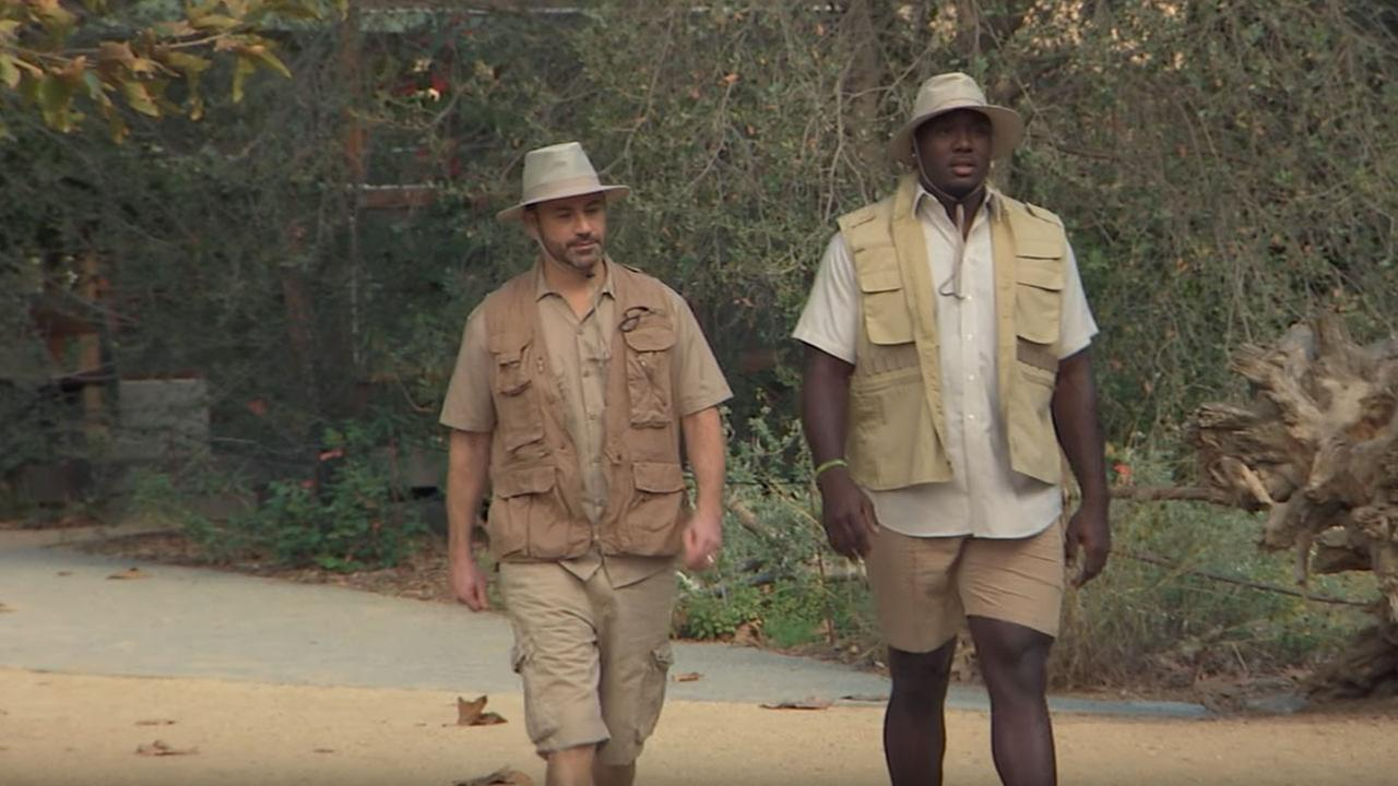 Jimmy Kimmel is shown walking with Los Angeles Rams player Williams Hayes during a segment on the Jimmy Kimmel Live! show.