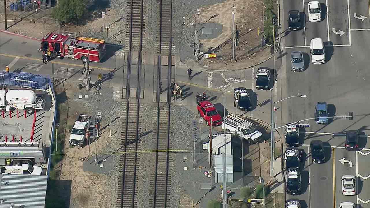 Firefighters and other emergency crews investigate the scene where a person was fatally struck by a train in Glendale on Monday, Nov. 21, 2016.