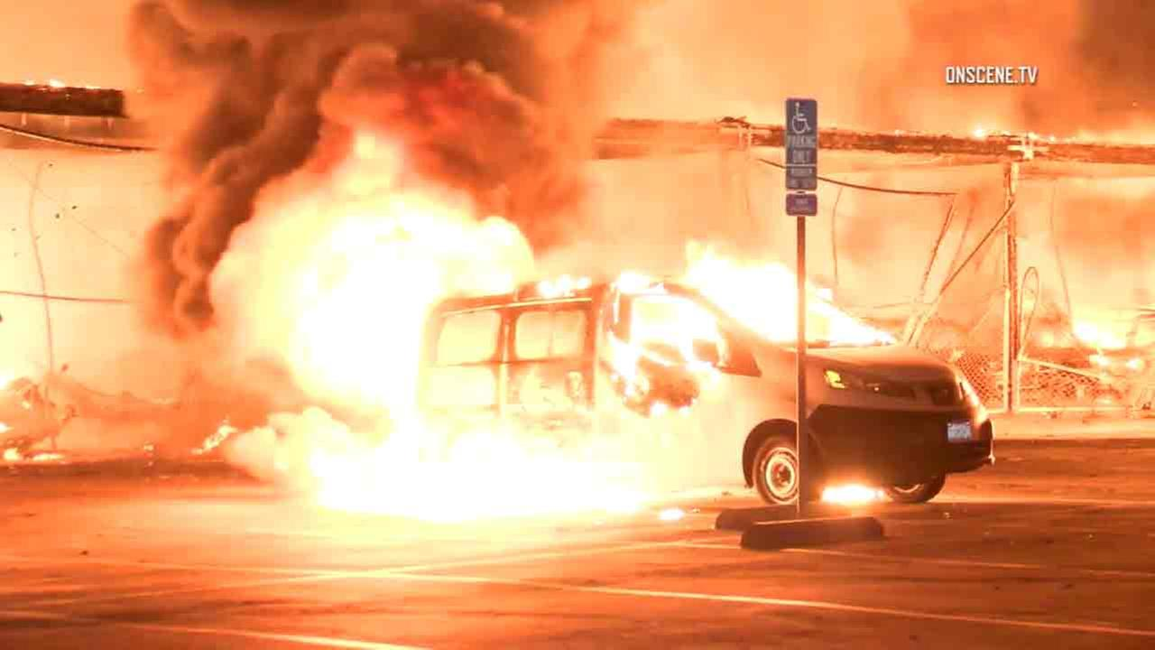 A van parked at a Newport Beach storage facility is caught in an explosive blaze on Nov. 11, 2016.