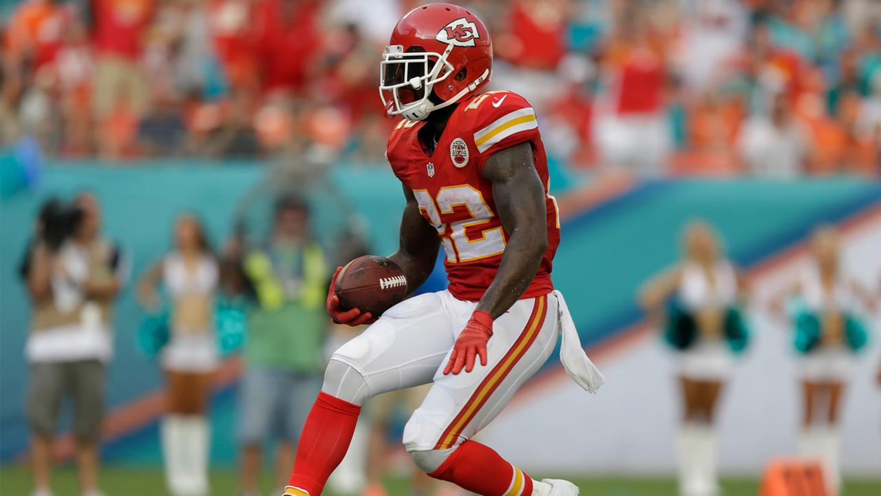 Kansas City Chiefs running back Joe McKnight scores a touchdown during the second half of an NFL football game against the Miami Dolphins, Sunday, Sept. 21, 2014.