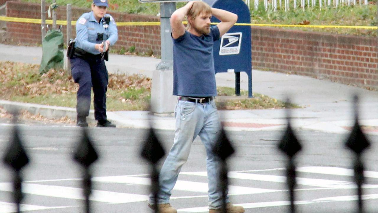Edgar Welch, 28 of Salisbury, N.C., surrenders to police Sunday, Dec. 4, 2016, in Washington. Welch, who said he was investigating a conspiracy theory, according to police.