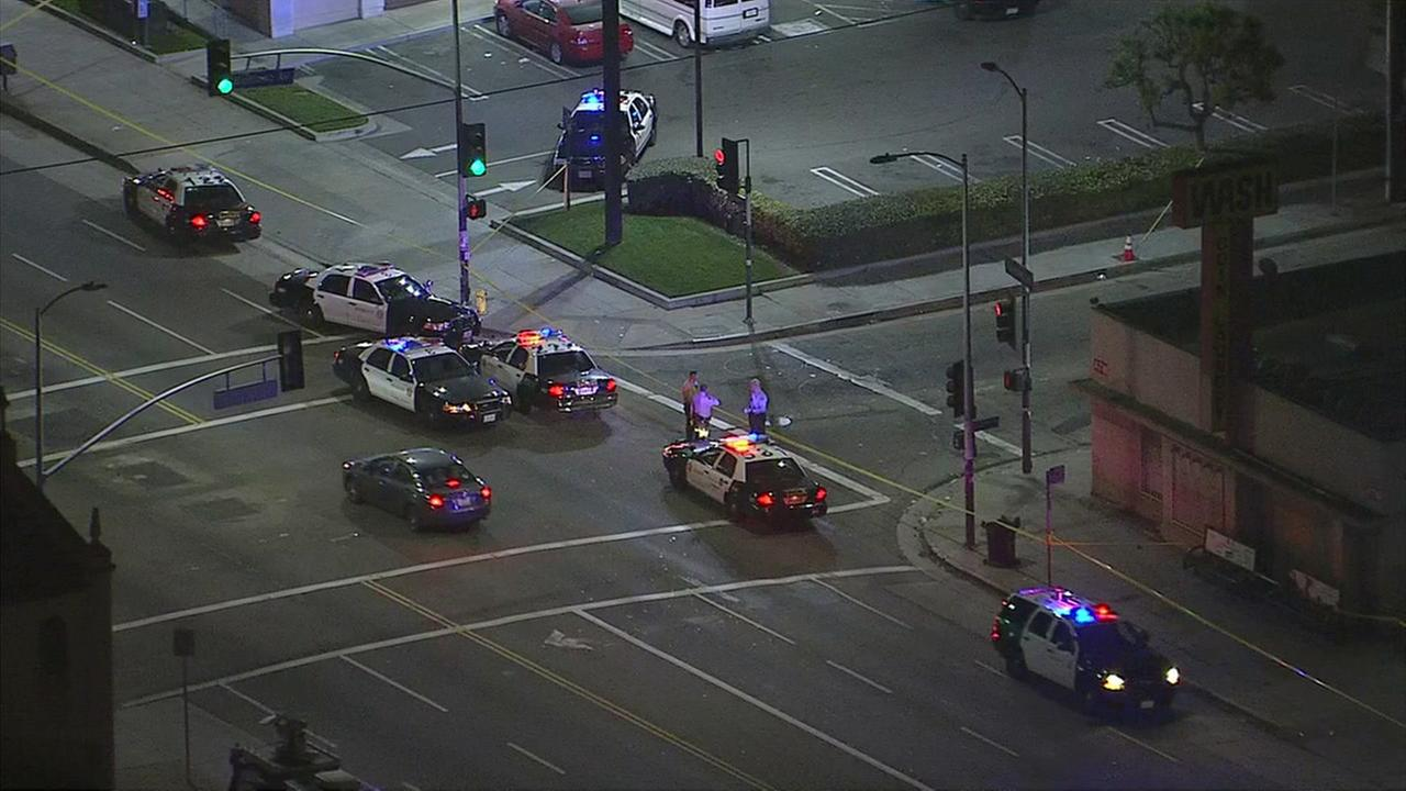 Authorities responded after a deputy-involved shooting in which an armed suspect on a bicycle was struck in South Los Angeles on Tuesday, Dec.  13, 2016.