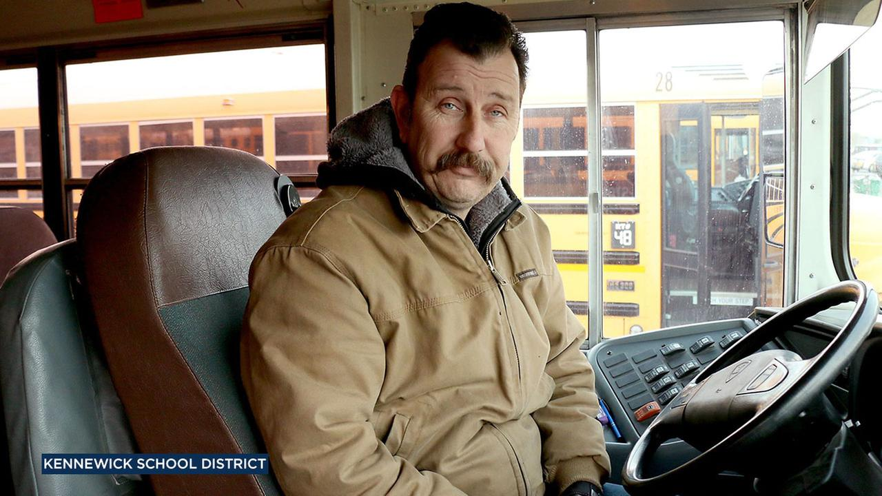 The Kennewick School District said bus driver John Lunceford bought hats and gloves to help students who were waiting in the cold.