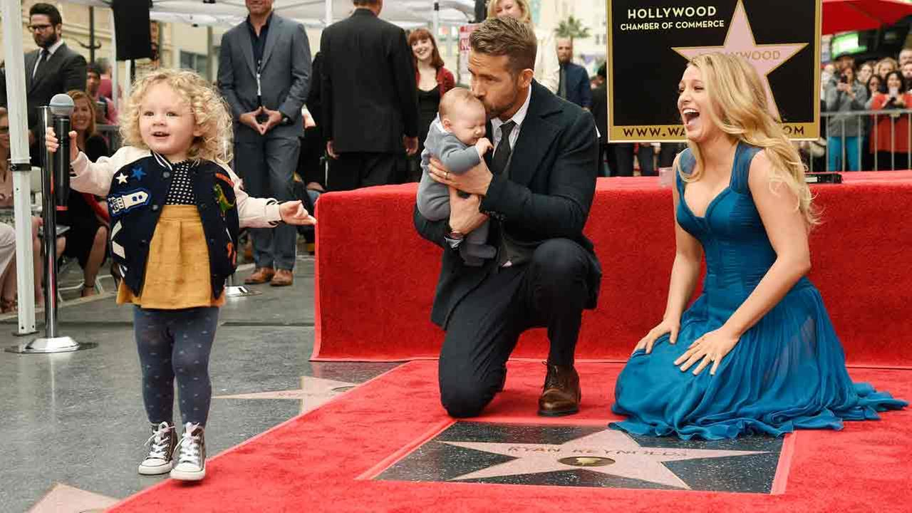 Ryan Reynolds daughter James steals the microphone as Reynolds poses with his wife, actress Blake Lively, and their youngest daughter on Thursday, Dec. 15, 2016.