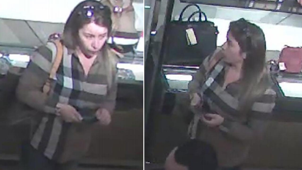A woman is shown on surveillance camera and is suspected of stealing about $24,000 worth of items from a persons car in Burbank on Dec. 10, 2016.