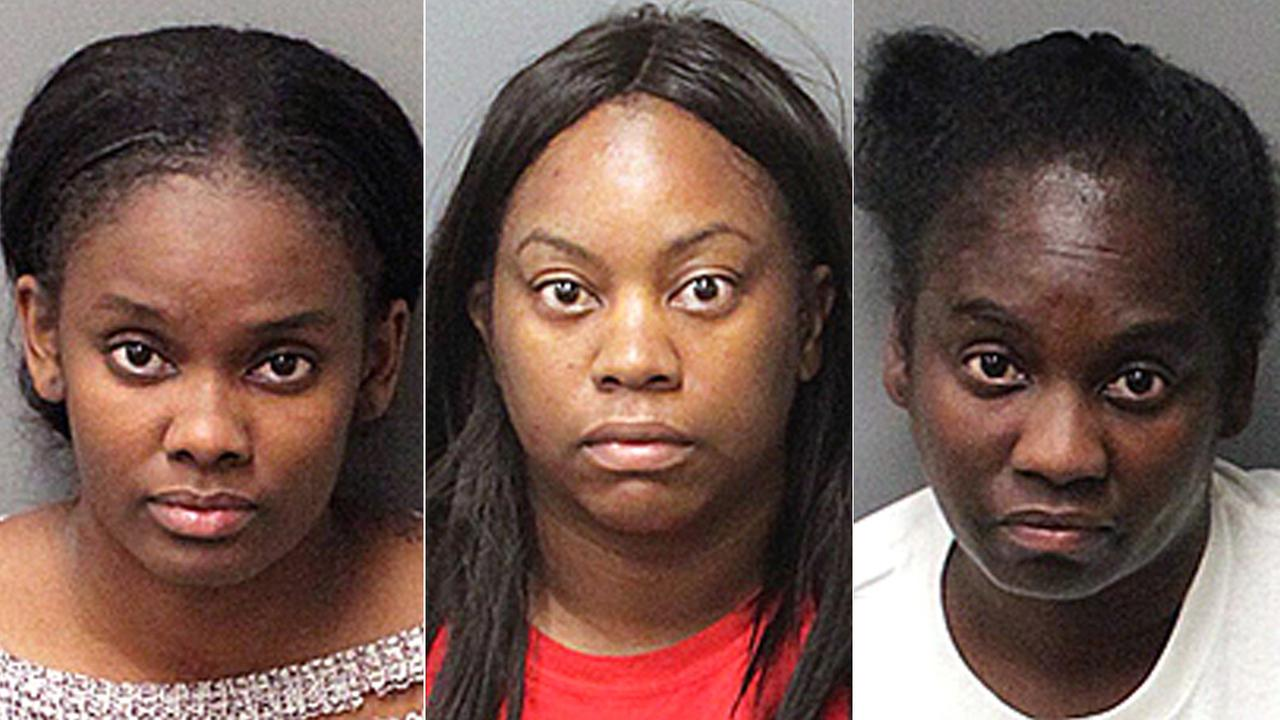 Sequoia Pratt, left, Tamera Gibson, center, and Tonette Gibson are seen in booking photos after being arrested Monday, Dec. 26, 2016.