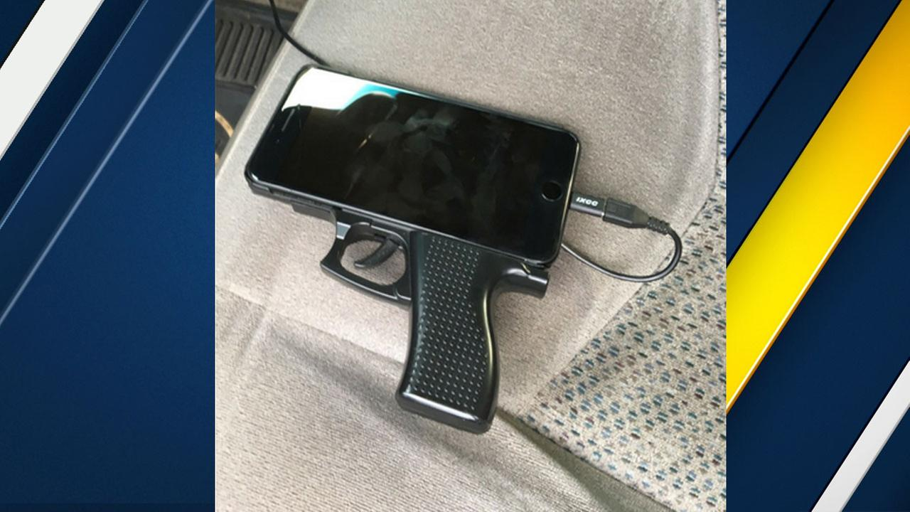 A cellphone case resembling a handgun is shown in a photo provided by the Alhambra Police Department on Friday, Dec. 30, 2016.