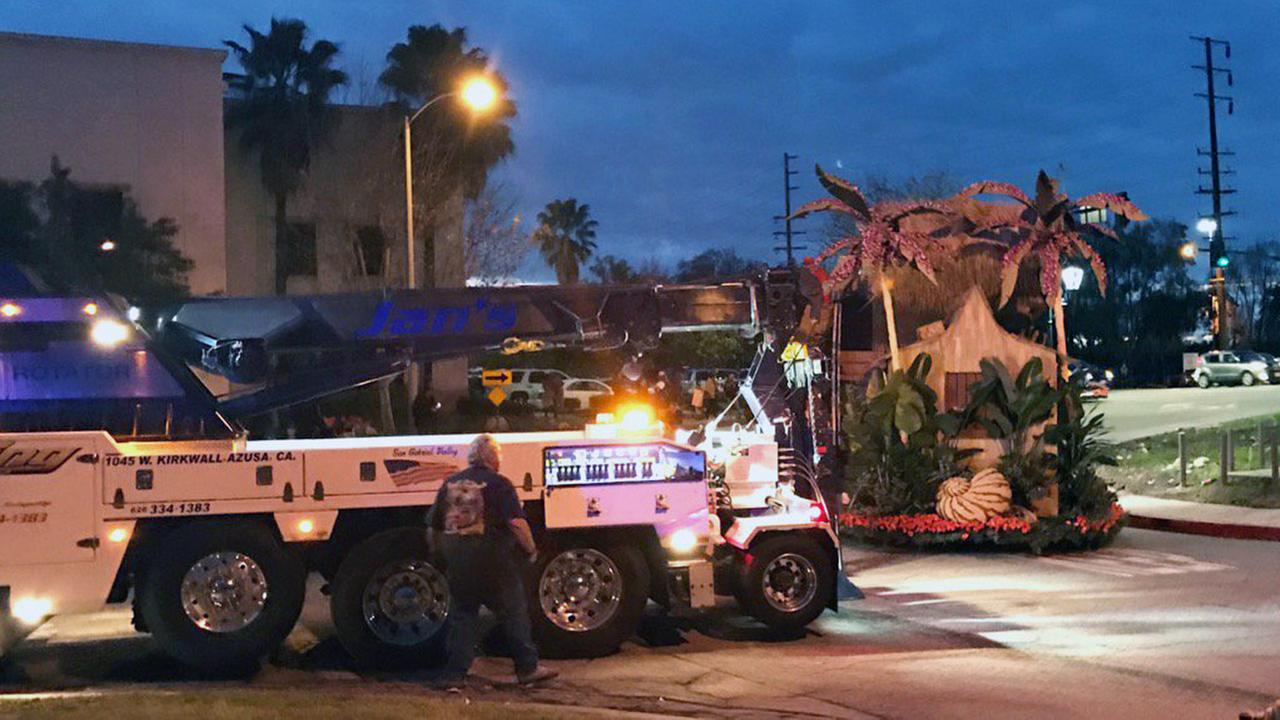 An 80-foot float got stuck on its way from Irwindale to Pasadena on Sunday, Jan. 1, 2017, before its big debut in the Rose Parade.