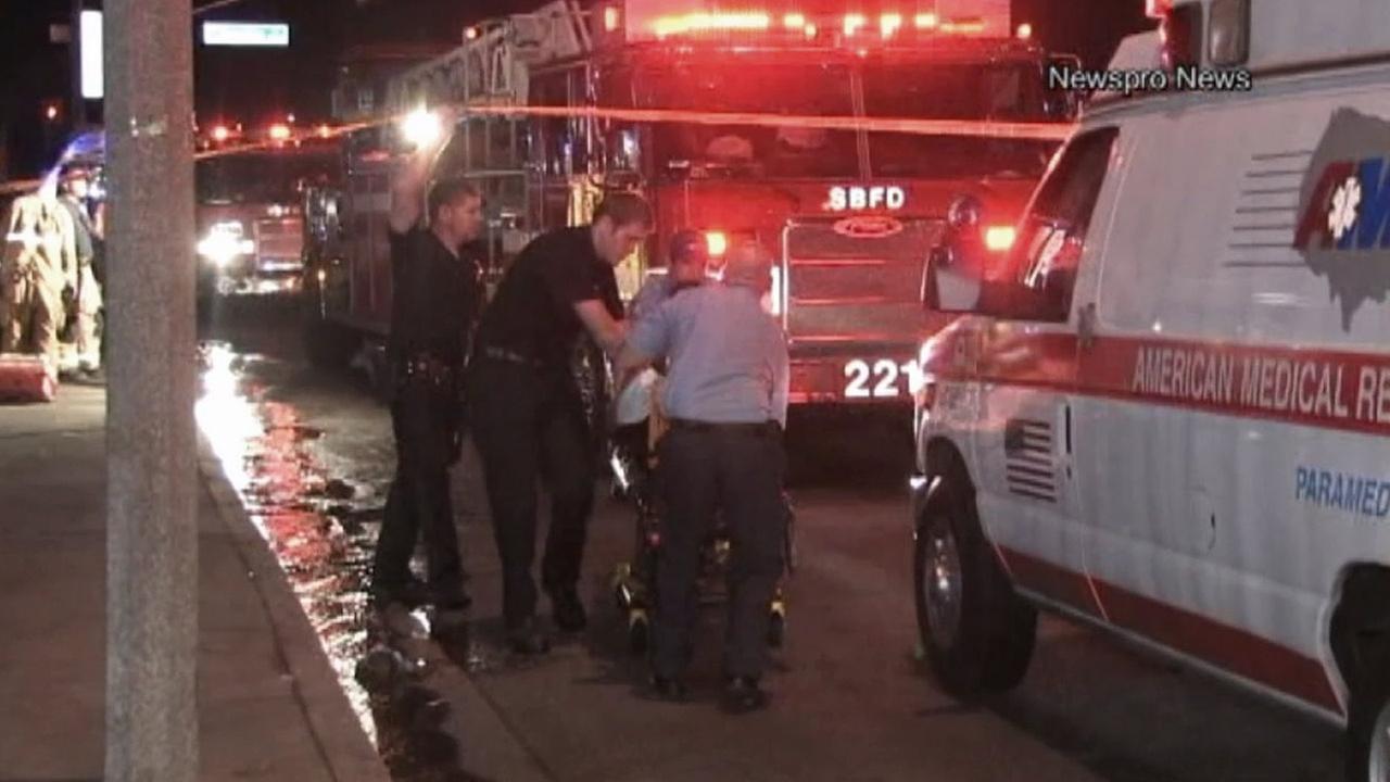 Paramedics get ready to load a shooting victim into their ambulance in San Bernardino on Monday, July 7, 2014.