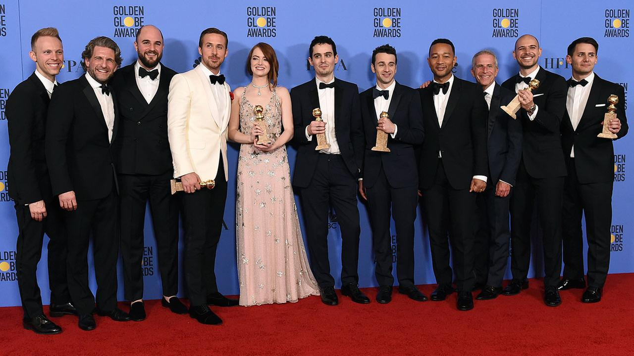The cast and crew of La La Land - which won seven awards - pose backstage at the Golden Globe awards in Beverly Hills on Sunday, Jan. 8, 2017.