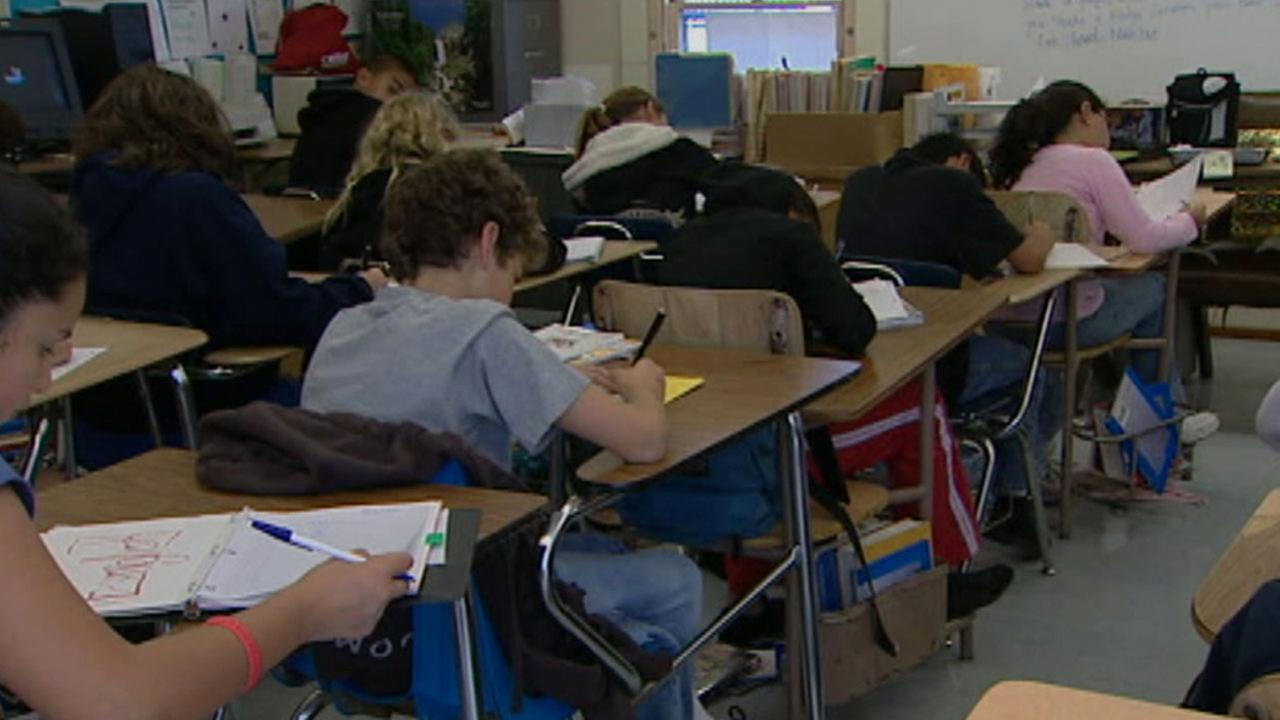 Students sit and study in a classroom in a file photo.