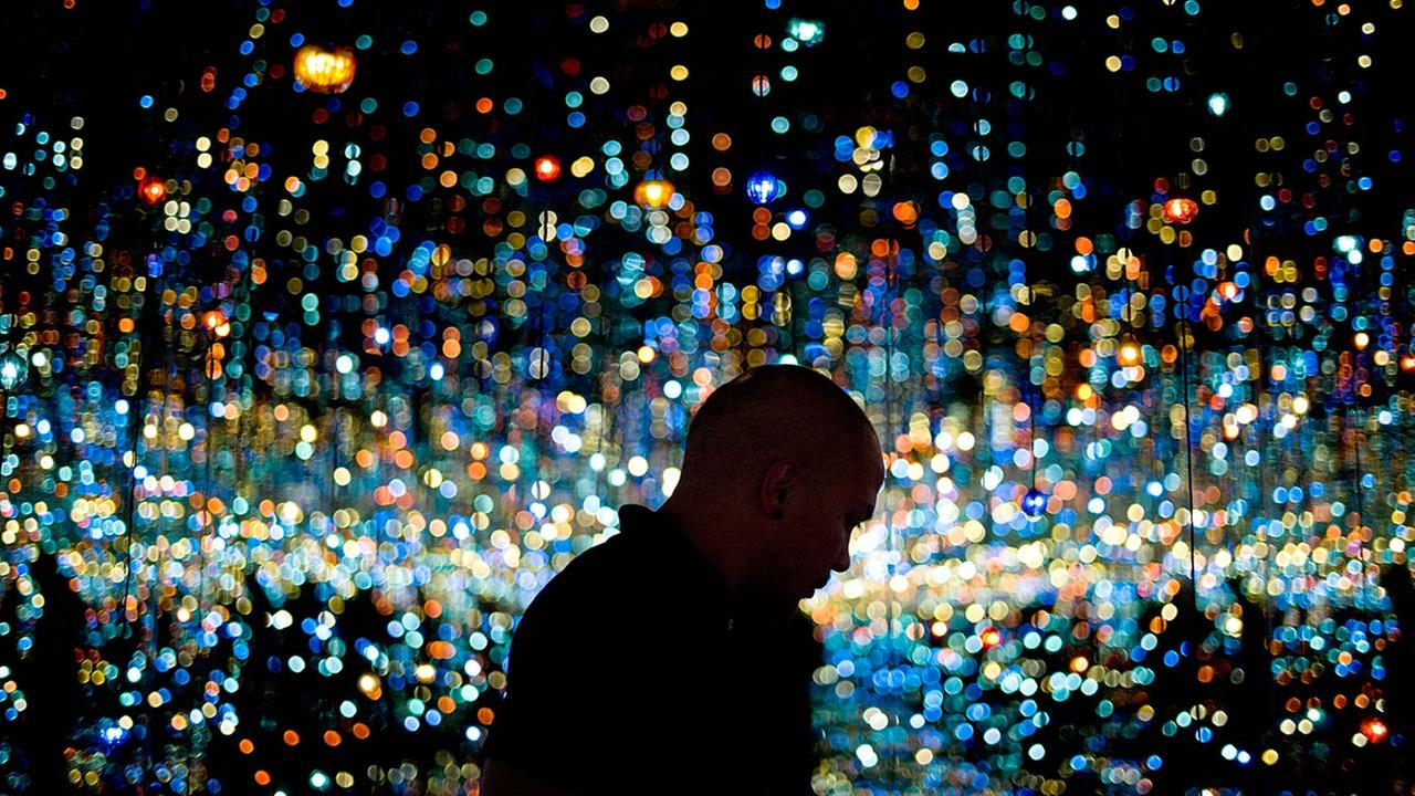 A visitor views Yayoi Kusamas Infinity Mirrored Room at the Broad Museum in downtown Los Angeles.