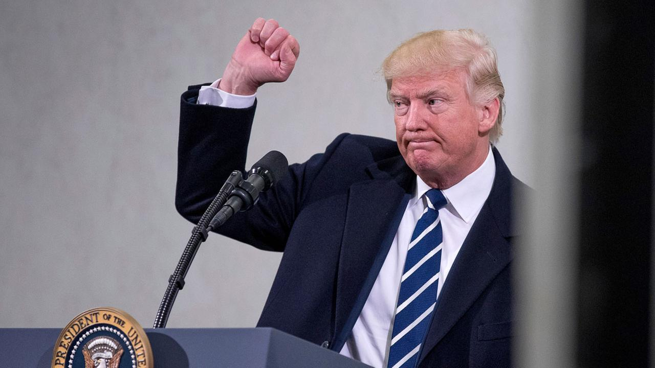 President Donald Trump holds up a fist after speaking at the Central Intelligence Agency in Langley, Va., Saturday, Jan. 21, 2017.