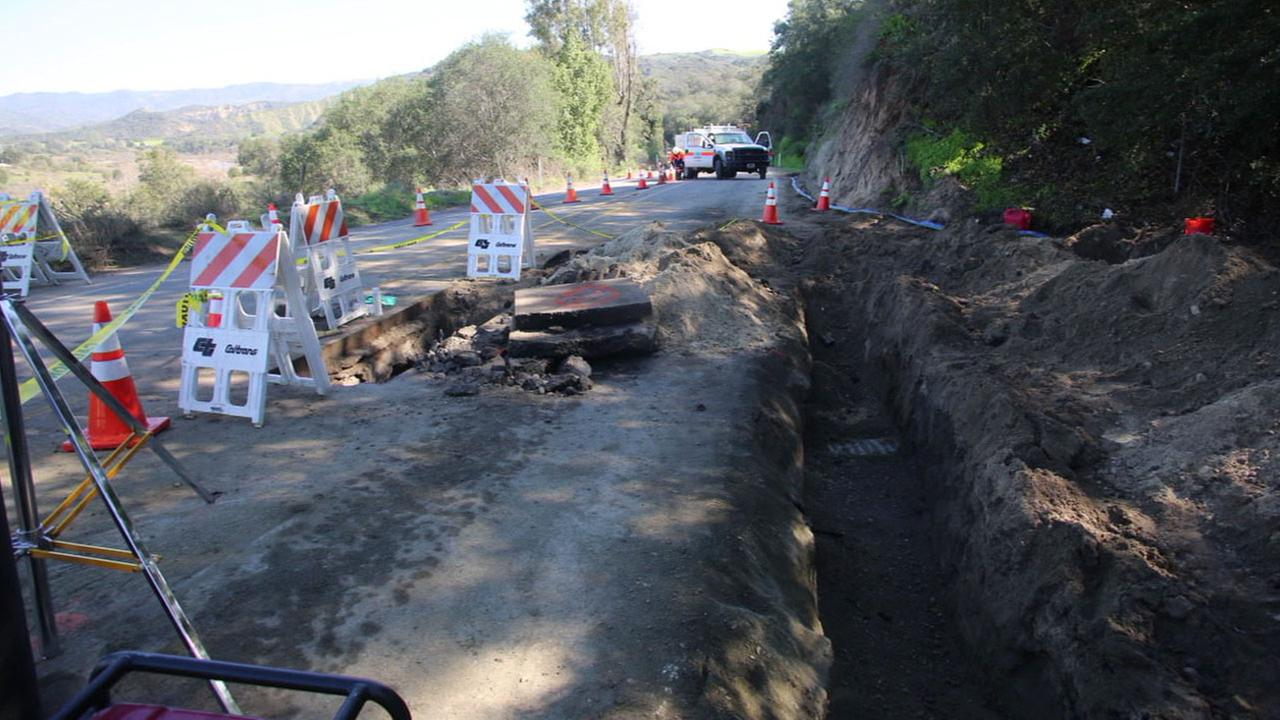 Caltrans crews work to repair a hole underneath the Ortega Highway between Lake Elsinore and Orange County.