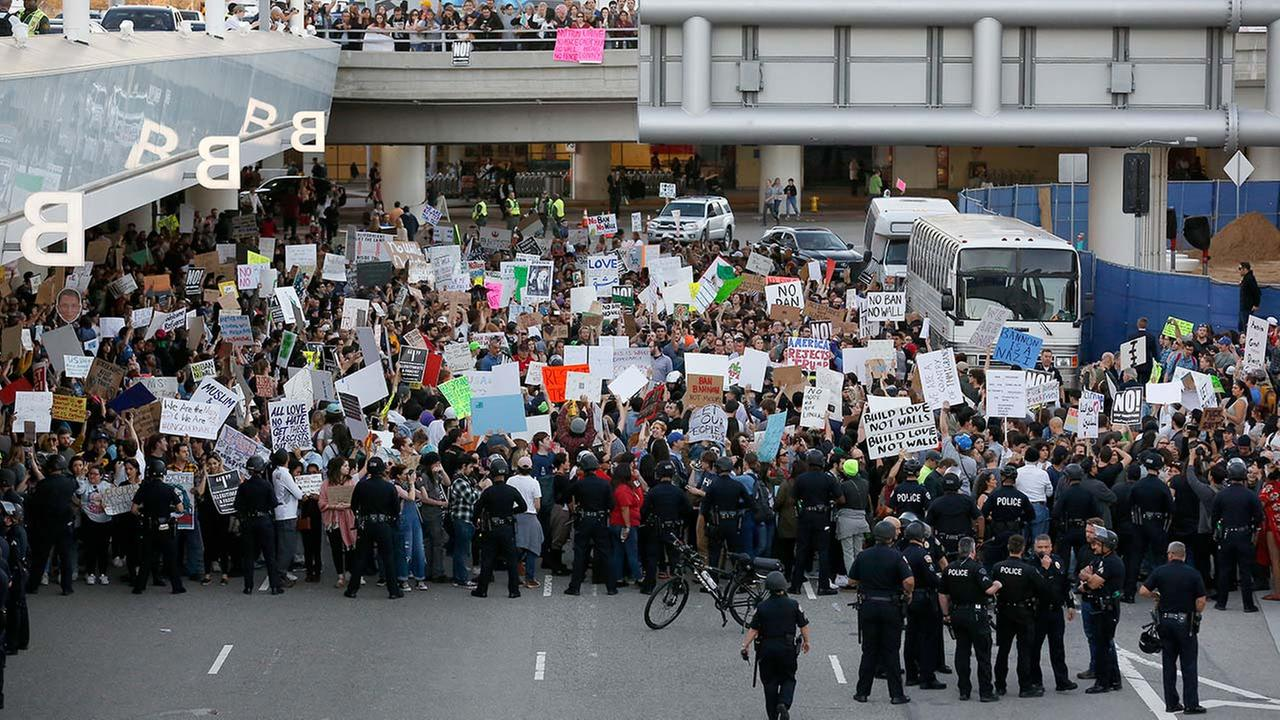 Police officers block demonstrators from marching on the lower roadway during a protest against President Donald Trumps travel ban at LAX on Sunday, Jan. 29, 2017.