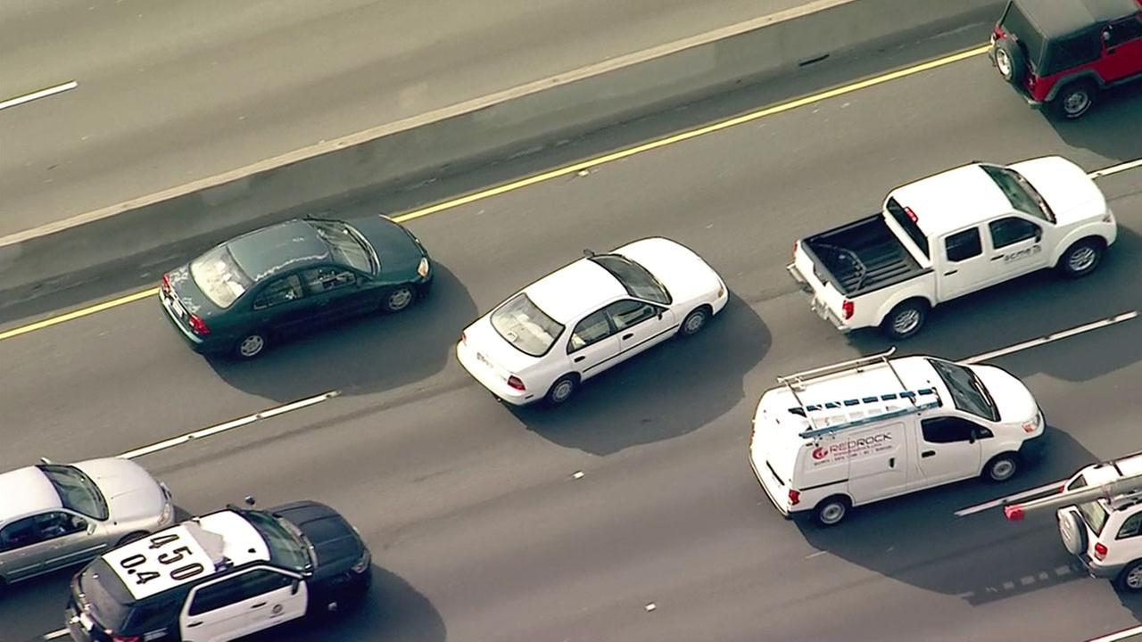 A stolen car suspect weaves through traffic on the northbound 5 Freeway in an attempt to evade police on Thursday, Feb. 2, 2017.