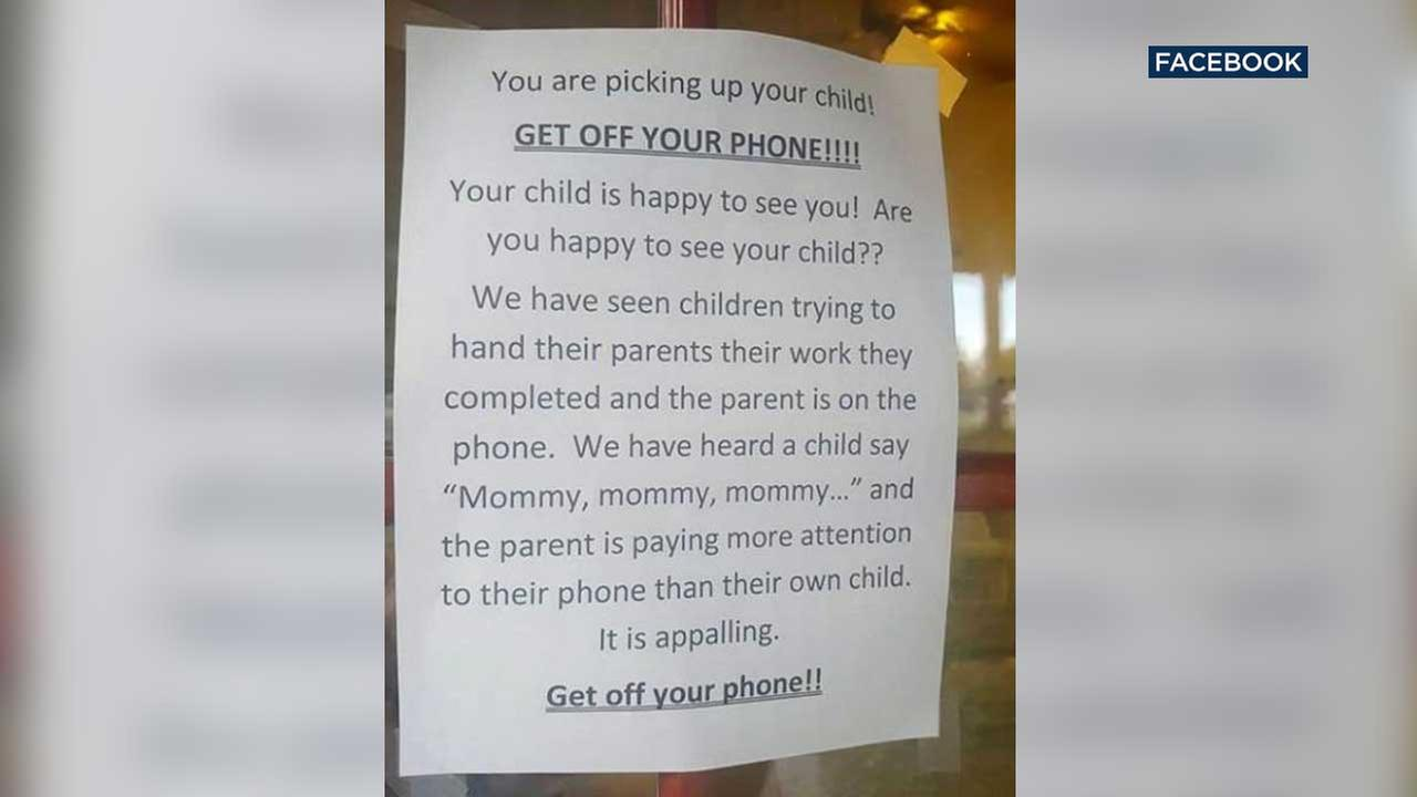 A sign posted at a Texas day care directs parents to get off your phone.