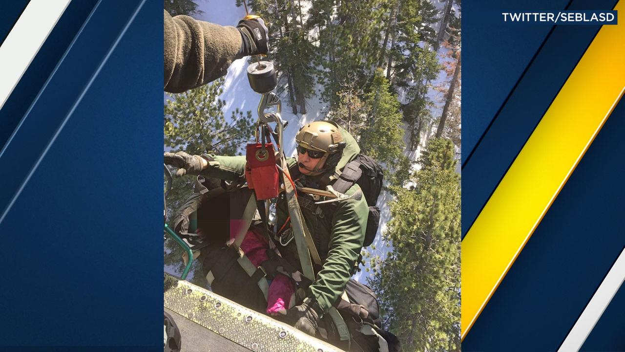 Authorities hoisted up an injured hiker who fell down an ice chute above Azusa near the Angeles Crest Highway on Saturday, Feb. 4, 2017.