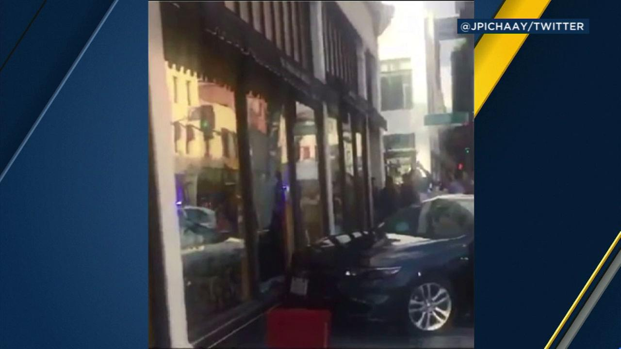 A BMW sedan seen crashed into a Cheesecake Factory in Pasadena on Saturday, Feb. 4, 2017.