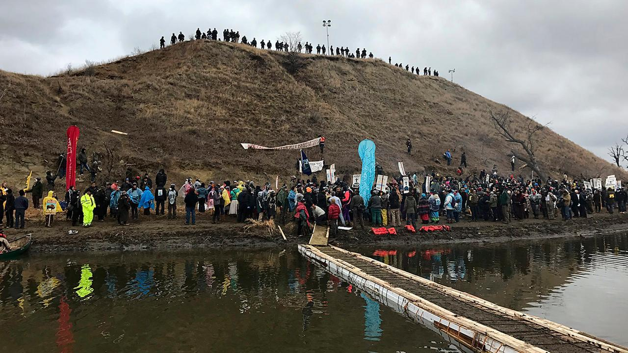 Protesters against the Dakota Access oil pipeline gather at and around a hill, referred to as Turtle Island, where demonstrators claim burial sites are located.