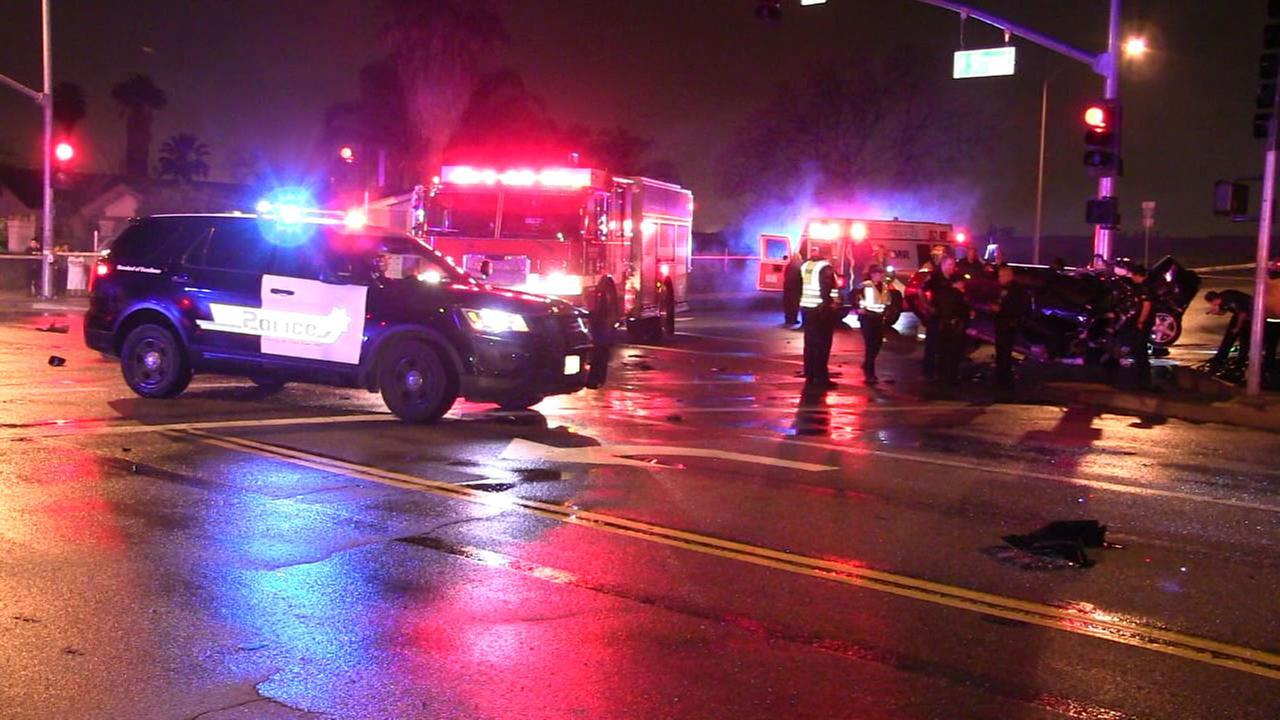 Authorities investigate the scene of a double-fatal single-car crash in San Bernardino on Saturday, Feb. 11, 2017.