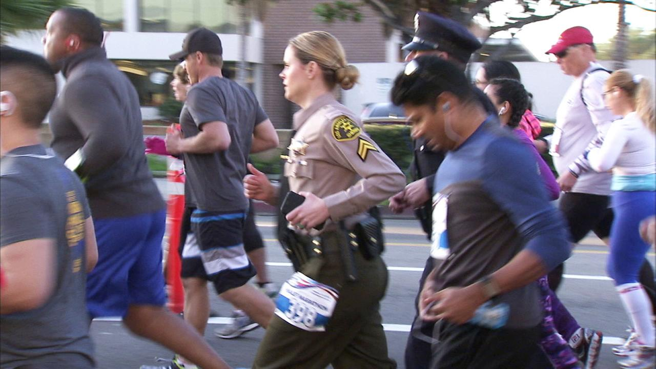 LASD Deputy Jenna Underwood Nunez runs in full uniform to honor her colleagues at the annual Run to Remember Los Angeles on Sunday, Feb. 12, 2017.