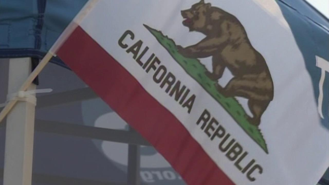 The California state flag is seen at a Yes California Independence Campaign booth in an undated file photo.