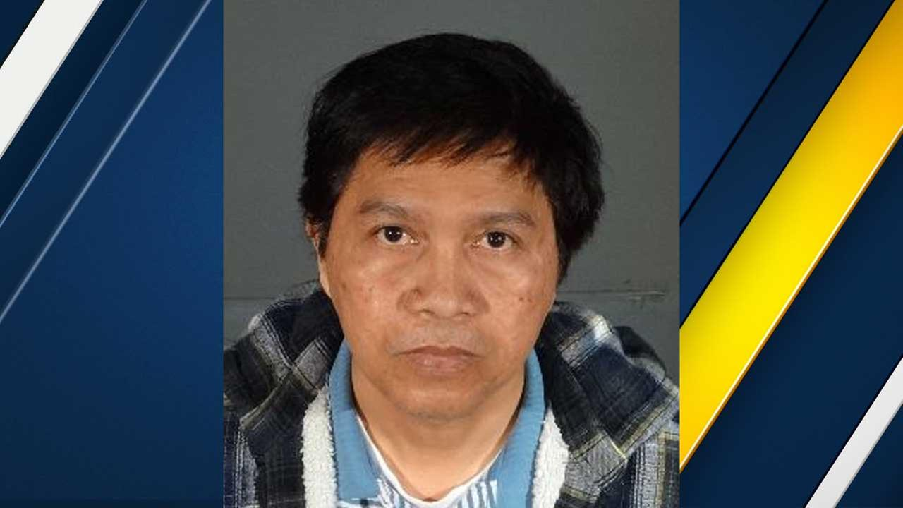 Amador Valencia Santos, also known as Omar, is seen in this booking photo from the Los Angeles Police Department.