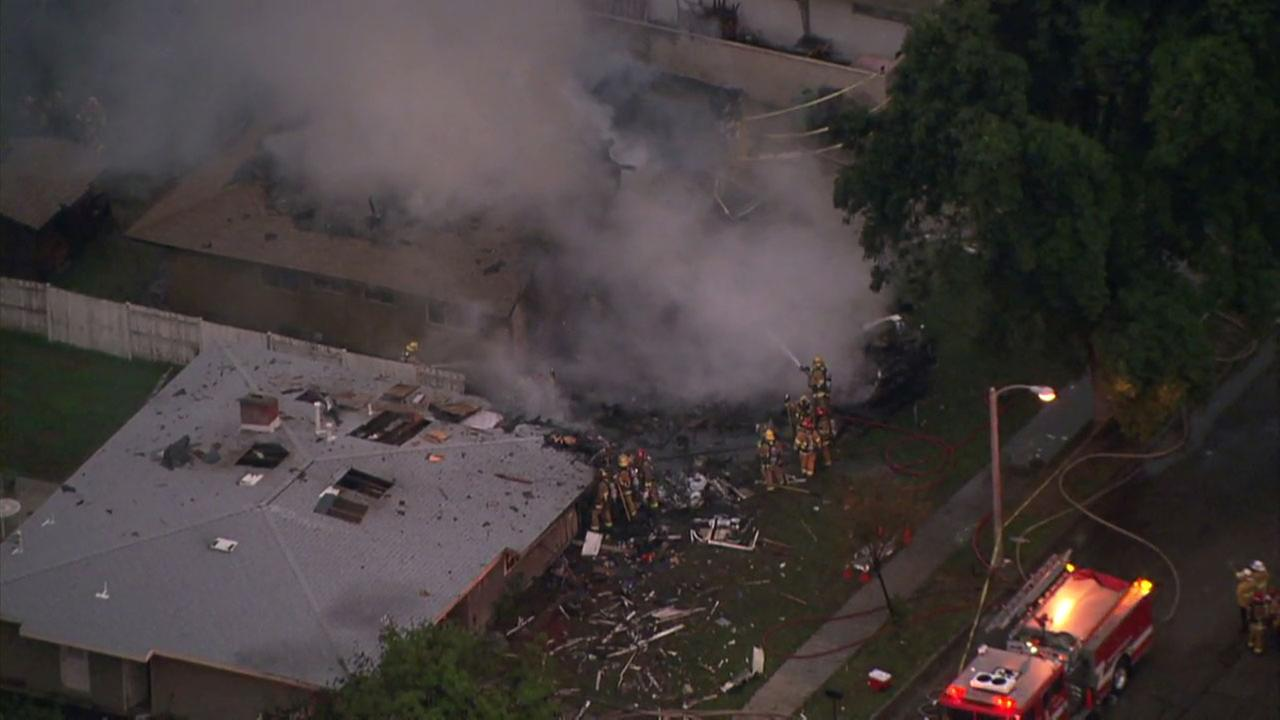 Firefighters continued to put out a fire after a home was destroyed when a plane crashed into it in Riverside on Monday, Feb. 27, 2017.