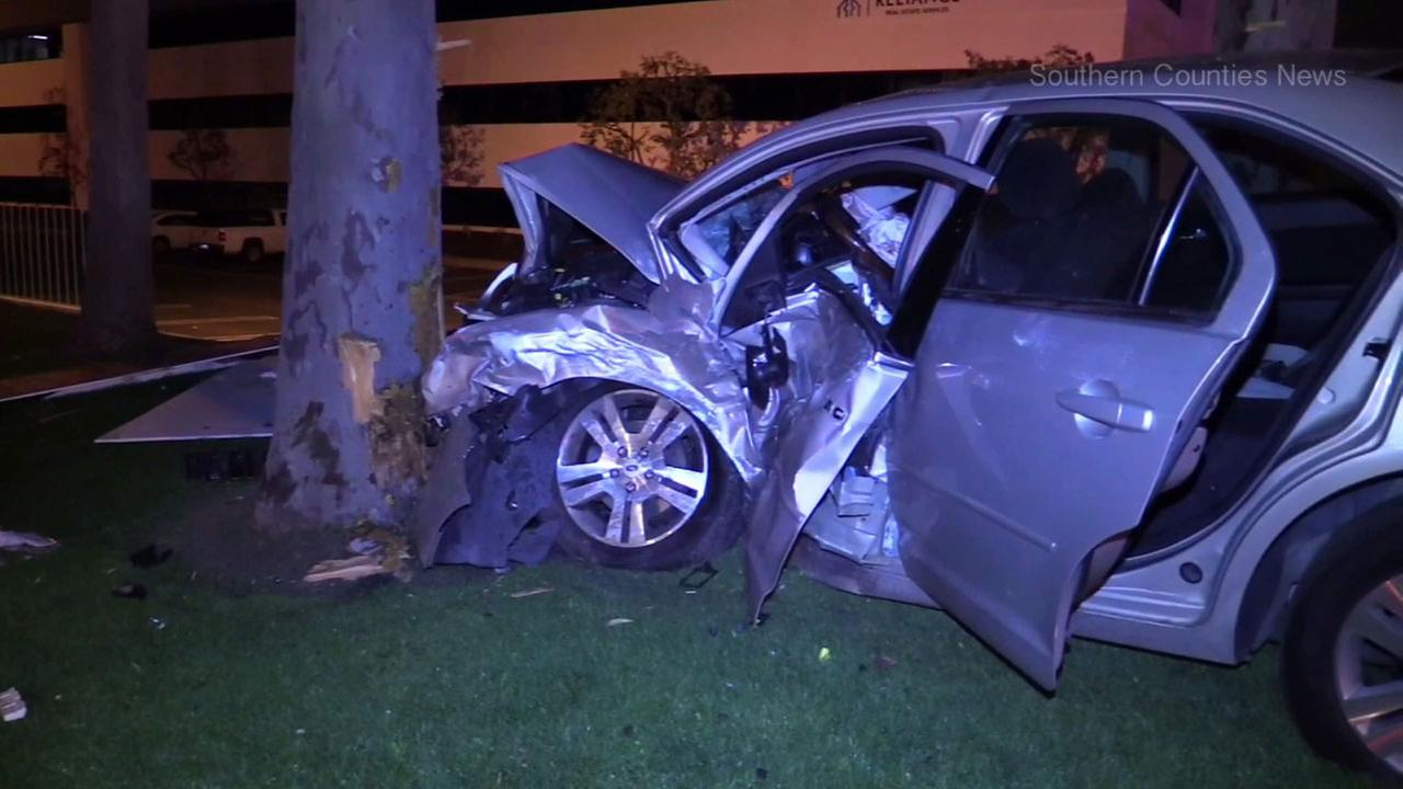 A vehicle seen mangled after crashing into a tree in a two-car collision that killed one person in Brea on Sunday, March 5, 2017.