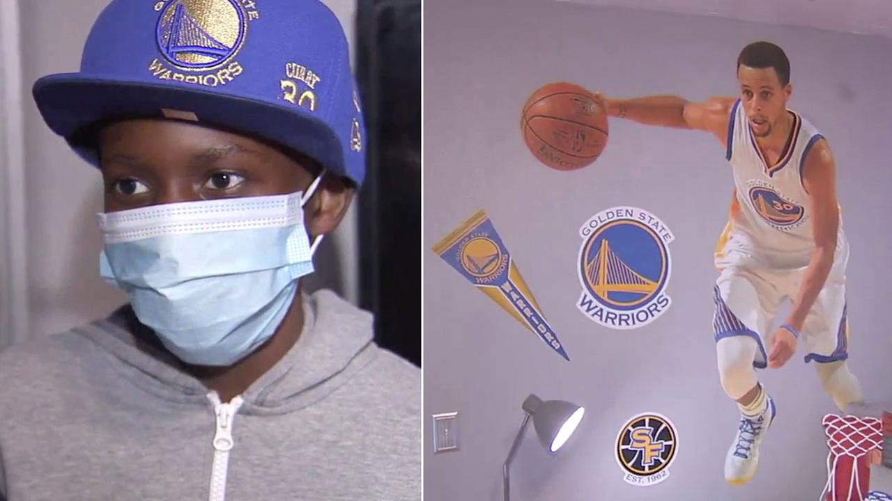 Jaylen Winzer, 13, is shown during an interview alongside an image of a Steph Curry wall decal in Jaylens newly redecorated room.