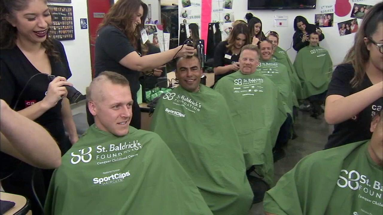 Firefighters with the Garden Grove Fire Department shaved their heads to raise money for childhood cancer research on Wednesday, March 15, 2017.