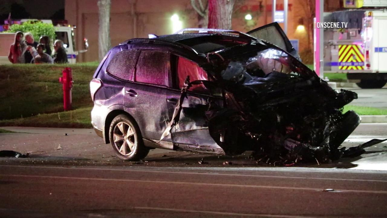 The wreckage of a car is seen at a Fontana intersection after a multi-vehicle crash on Tuesday, March 21, 2017.