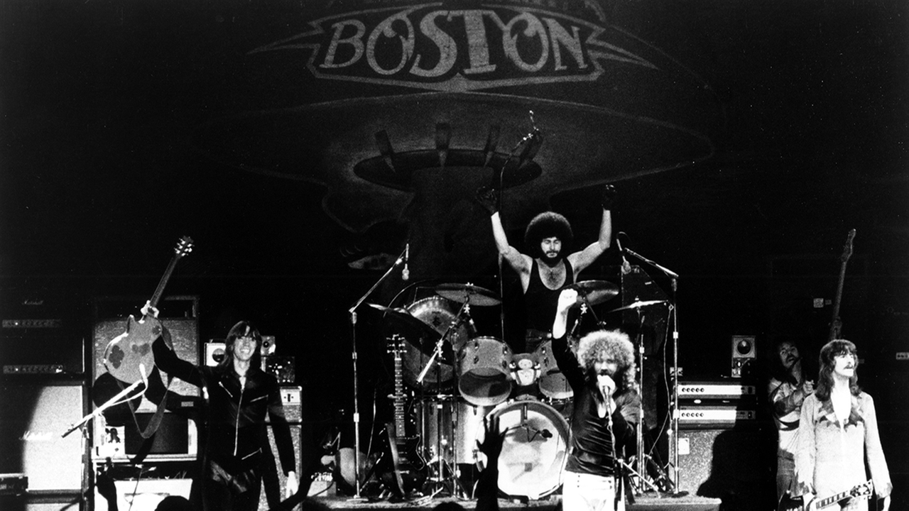 CIRCA 1978: (L-R) Tom Scholz, Sib Hashian, Brad Delp, Barry Goudreau and Fran Sheehan of the rock group Boston perform onstage in circa 1978.