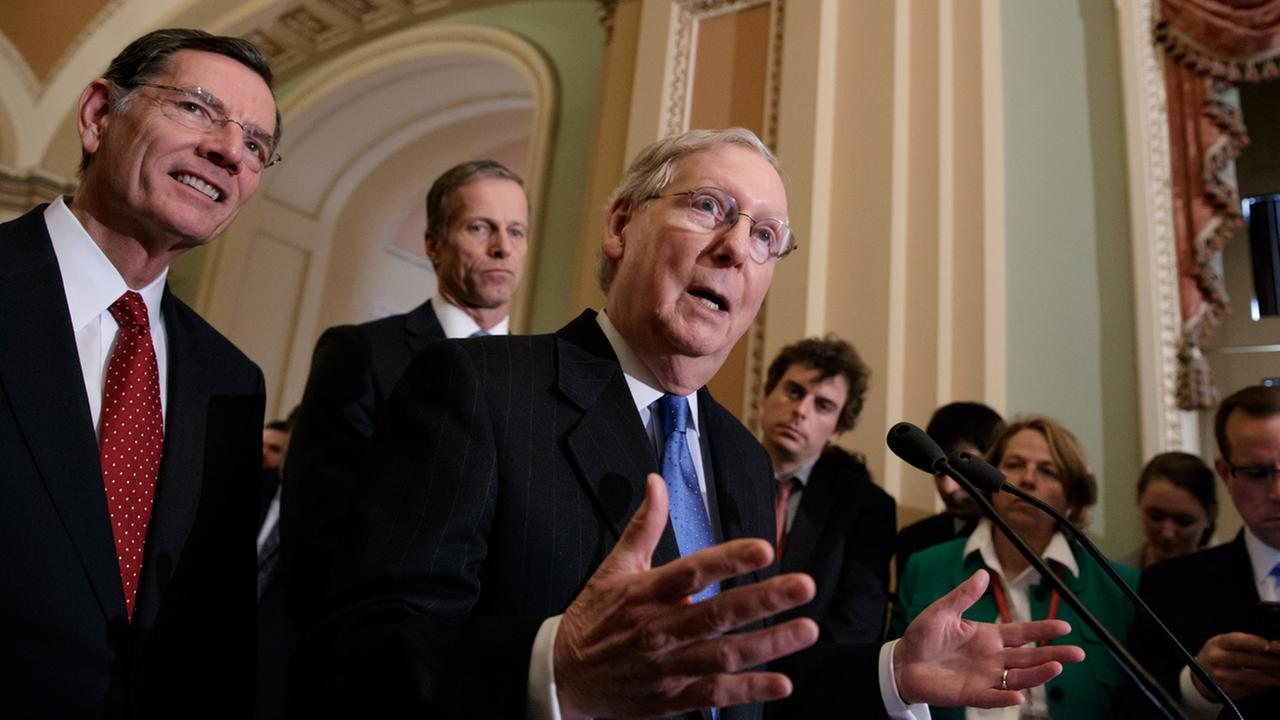 Senate Majority Leader Mitch McConnell of Ky., joined by Sen. John Barrasso, R-Wyo., left, and Sen. John Thune, R-S.D., speak to reporters about the pending GOP health care bill.