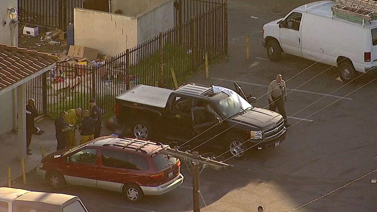 Two bodies were seen at the site of a triple shooting in South Los Angeles on Thursday, March 23, 2017.