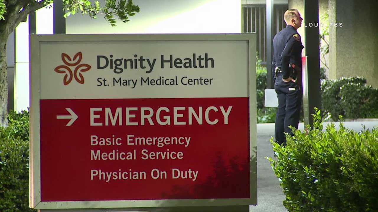 A law enforcement official is seen outside St. Mary Medical Center in Long Beach on Tuesday, March 28, 2017.