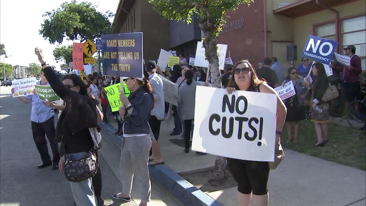 Protesters gathered outside the Montebello Unified School District meeting to protest layoff notices issued to employees.