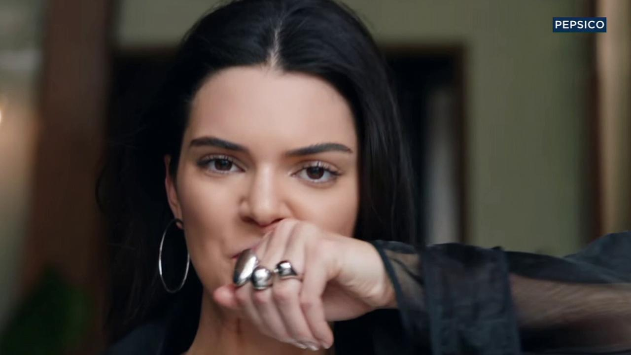 Kendall Jenner is seen in a Pepsi ad titled Live for Now Moments.