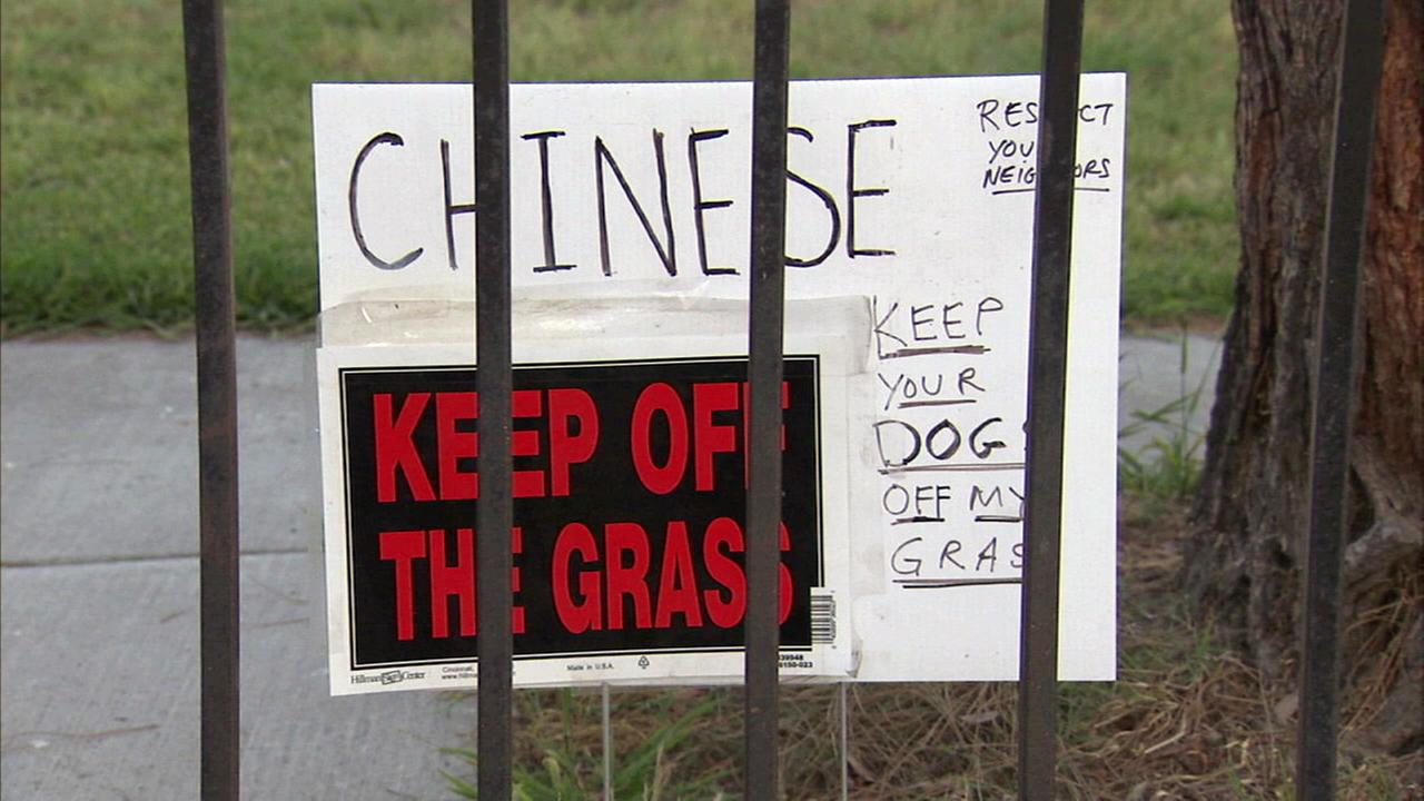 El Monte neighbors said they were upset after a man posted a sign that said Chinese, keep your dogs off my grass.