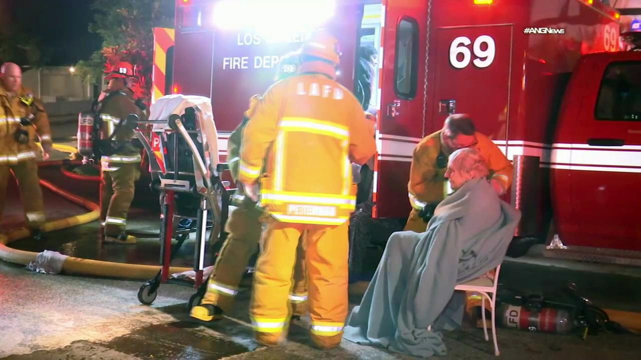 Five people were injured, including two critically, after a fire ripped through two homes 16500 block of W. Las Casas Place in Pacific Palisades on Thursday, April 13, 2017.