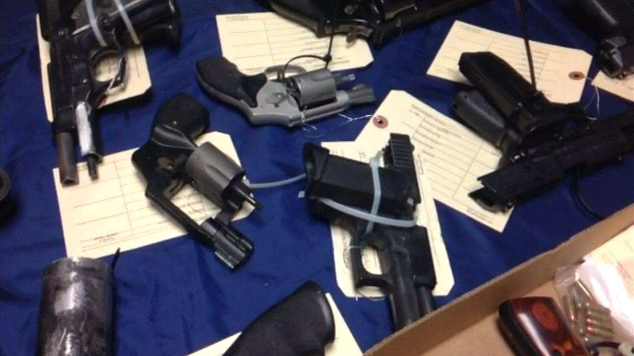 Guns are shown on display in a file photo.